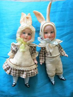 Two bisque rabbit dolls /boy and girl /glass eyes/Hertwig/Germany