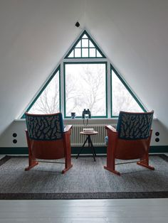 Dark turquoise trim throughout the house and LOVE those salvaged chairs! Old auditorium seats perhaps?