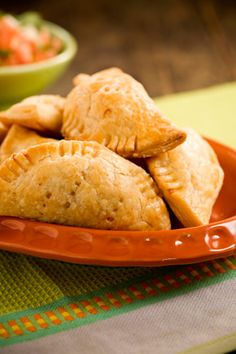 Paula Deen Chicken Empanadas. Looks too easy (and they're not fried). I can think of a whole bunch of different stuffings: shredded BBQ, breakfast fixin's, spinaches, ham/cheese, etc.