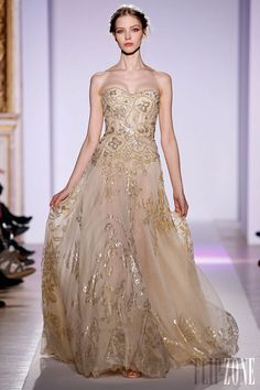 Zuhair Murad - Couture - Official pictures, S/S 2013 - http://en.flip-zone.com/fashion/couture-1/fashion-houses/zuhair-murad-3366 - Long backless siren dress in champagne tulle, plunging neckline in gold pearl plumage.