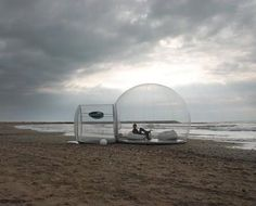 Inflatable lawn tent. Imagine watching a thunderstorm or the rain in something like that!