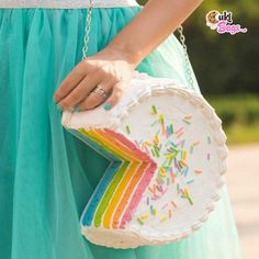 These Cake Purses Are Insanely Cute — And Won't Ruin Your Diet Rainbow Layer Cakes, Cake Rainbow, Whipped Cream Cakes, White Buttercream, Rainbow Sprinkles, Purple, Pink, Green Aqua, Orange Yellow
