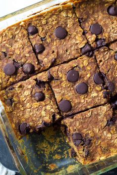 A Skinny Chocolate Chip Pumpkin Bars Recipe, filled with fall spices, pumpkin puree, oats, and dark chocolate! ALL only 107 calories a serving!   joyfulhealthyeats.com #recipes