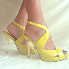Gold Heeled, yellow sandals by Bakers Size 6.5 Sexy attention grabbing heels in very good condition!  Gorgeous yellow color and gold spike heels.  Hardly worn. Bakers Shoes Heels