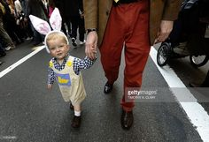 Easter parade fan Peter, age 2 with his dad dressed up during the 2011 Easter Parade and Easter Bonnet Festival in New York City on 5th Avenue April 24, 2011.