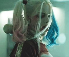Harley Quinn. Her blowing on her hair like that was improve!