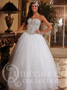 Quinceanera ball gown, strapless sweetheart neckline, sequin bodice, with boning & crystal appliques detail, very full layered tulle skirt with sparkled beading, lace up back. Tulle