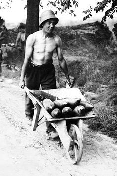 A young British soldier transporting shells, Messines, Belgium, 1917.