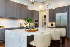 Check out this transitional eat-in kitchen with stunning marble island on HGTV.com. Kitchen Cabinet Layout, Dark Kitchen Cabinets, Old Cabinets, Grey Cabinets, Eat In Kitchen, Kitchen Dining, Marble Island, Dark House, Tile Countertops