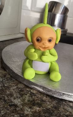 ideas from Claire jolly Fondant Molds, Fondant Figures, Teletubbies Cake, Bed Cake, Disney Themed Cakes, Lily Cake, Fondant Animals, Character Cakes, Fondant Tutorial