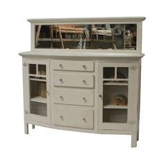 Bev: Bev is a vintage hutch with a distressed white finish. She has four drawers and two side cupboards. She makes a great beverage bar. Sundrop Vintage Rentals/ Rent Vintage Furniture in California for Weddings/ Parties/ Events/ Photo shoot/ Bridal Shower/ Sofa /Settee/ Vintage/ Boho/ Baby Shower/ Rentals