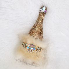 Holiday Champagne Bottle with rhinestone and beaded detail and fur.   Contact to…