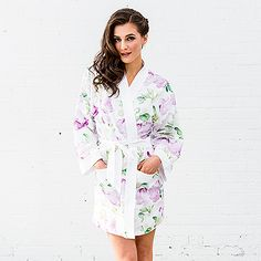 Soft and silky, this floral printed kimono style robe features shades of lavender and green on a crisp white background. A stunning gift for the bride or the bridesmaids for the pre-wedding get together. Add embroidered personalization for a special touch.