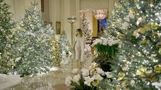 First Lady Melania Trump put the final touches on this year's White House Christmas decor in a custom knit dress by Hervé Pierre.