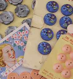 Blue and pink vintage buttons on original cards.