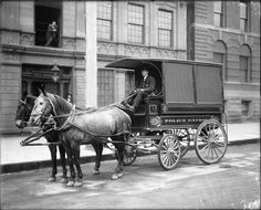 Salt Lake City Police patrol wagon, December 24, 1907. This photograph is taken in front of the old City Hall, which became Police Headquarters following the construction of the City and County Building.