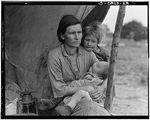 """""""Nipomo, Calif. Mar. 1936. Migrant agricultural worker's family. Seven hungry children. Mother aged 32, the father is a native Californian. Destitute in a pea pickers camp, because of the failure of the early pea crop. These people had just sold their tent in order to buy food. Most of the 2,500 people in this camp were destitute."""""""