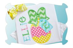 Easter Egg With Gift Tag Applique ~ One of our favorites for the season, featuring a quick stitch out. Font shown on shirt and on gift tag is Party Time Embroidery Font and is available as a separate purchase.
