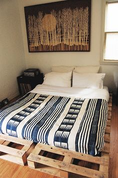 Love the wooden pallets under the bed! Cool idea!