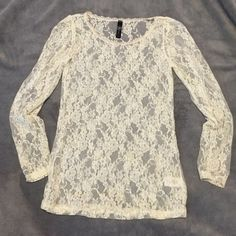 Beautiful cream lace top This top is so versatile. Wear with any color tank and look classy! Never worn. Tops