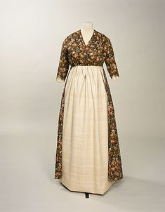 1790s dress, Manchester Galleries.  a print overdress over a white muslin round gown.