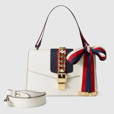 b8567b87739878 Shop the Sylvie small shoulder bag by Gucci. A playful mix of House codes,