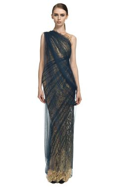 This embroidered illusion column gown from Marchesa features a hand-draped asymmetrical tulle overlay Back zip 100% silk over metallic thread embroidery Self-lined Made in USAPlease note: This item is returnable for credit or full refundShoes are for styling purposes only