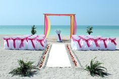 myrtle beach weddings with pink orange and yellow colors | Whispering Sands - Beach Wedding Package Florida