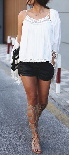 Black shorts, white top & nude Zara gladiator sandals.