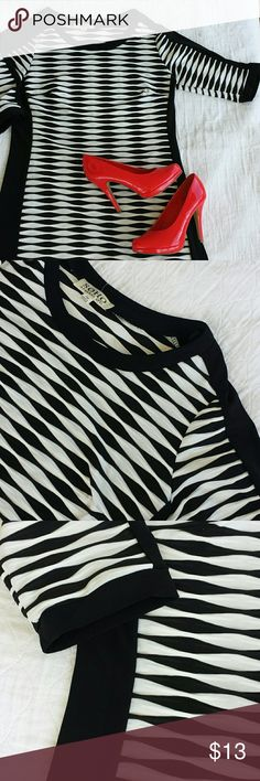 Textured black & white dress Only worn a few times! 3/4 sleeves, textured knit dress, bust darts. Very slimming and flattering on. My daughter has too many black and white dresses and needs to get rid of a few. SOHO Dresses Midi