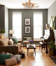 eclectic grey room. Love the paint color!