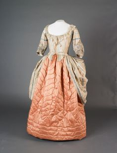 Silk robe a la polonaise with a quilted under skirt, ca 1769. British.