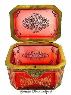 A Super French 19th Century Red Glass Casket beautifully decorated with gold
