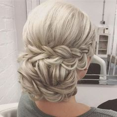 Bridal low bun with twists and braids. Perfect style for a two tier Gabriela veil. The comb just slides into the low bun.