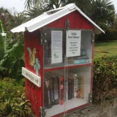 Barbara Smith. Paget, Bermuda. I enlisted the help of my son, Anthony to build the library, my son, Tim to make a sign and my daughter-in-law, Michele to use her imagination with the artwork. It has only been up for a week and people have stopped to see what this little box is about. I am happy to say, the word is out and people are taking books and I have found many are leaving more than they have taken so the library is overflowing!