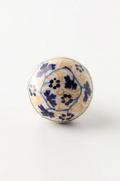 Love the idea of using mix and matched knobs on kitchen cabinets. Floral Marius Knob