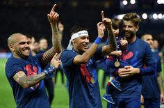 Daniel Alves (L) and Neymar of Barcelona celebrate victory as team mate Gerard Pique looks on during the UEFA Champions League Final between Juventus and FC Barcelona at Olympiastadion on June 6, 2015 in Berlin, Germany.