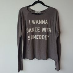 Wildfox I Wanna Dance with Somebody Wildfox Dance with Somebody tee  Preowned- good condition. Some mild pilling from normal wash and wear. Made of 50% cotton/ 50% polyester. Size Large. Measurements: underarm to underarm approximately 22 inches. Back of neck to bottom of hem is approximately 23 inches. Wildfox Tops Tees - Long Sleeve