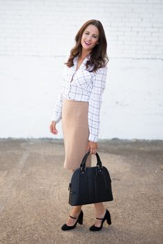The Miller Affect wearing a black tote and black mary jane heels from Nordstrom