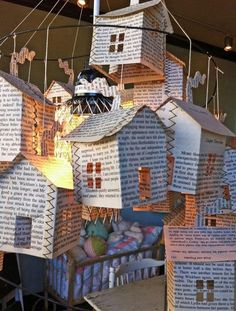 Book Page Chandelier - 20  Clever and Cool Old Book Art Examples, http://hative.com/old-book-art-examples/,