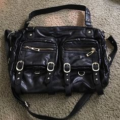 Used a few times but in very good condition. Black satchel/purse with gold detail Macy's Bags Crossbody Bags