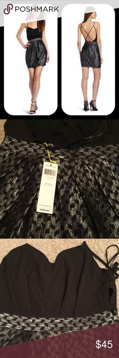 NWT BCBGeneration Crisscross Back Spaghetti NWT BCBGeneration Crisscross Back Spaghetti Strap Black Silver Dress.78% Polyester/22% Metallic Machine Wash! dress has a low cut back with a criss cross strap. This dress hits above the knee. Retail $120 BCBGeneration Dresses Mini