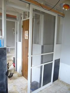 sliding doors in chicken coop; this make perfect sense, less space than swinging open the door.