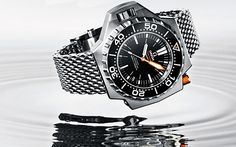 Omega re-releases the ProPlof Diver's Watch, the same model as the one Jacques Cousteau wore but with a lot more improvements and a brand-new coaxial watch movement. Big Watches, Sport Watches, Cool Watches, Watches For Men, Elegant Watches, Stylish Watches, Luxury Watches, Omega Seamaster Diver, Omega Seamaster Automatic