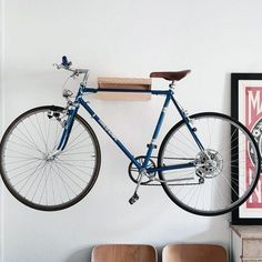 From overhead to on the wall and beyond, discover the top 70 best bike storage ideas. Explore unique and creative bicycle organization designs. Bike Hooks, Bike Hanger, Bike Rack, Bike Storage Solutions, Storage Ideas, Bike Storage Apartment, Bike Wall Mount, Bicycle Decor, Wood Bike