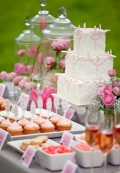 Wedding cake with vases, candy & cupcakes