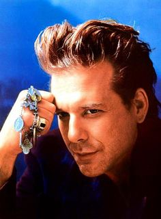 ALWAYS brooding..Mickey Rourke
