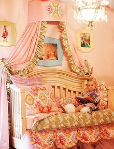 Elaborate Details: This toddler bed has been transformed into an extremely elaborate and chic big girl bed with a canopy and chandelier. Pinned by Belen Gomes via My Family Inspires.Visit our Dream Kids Rooms Pinterest Board to see the rest of our dream room picks, including some unique nurseries!Photo Source: My Family Inspires