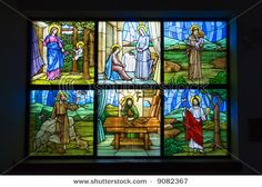 A colorful six pane stained glass church window