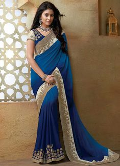 Shriya Saran Shaded Blue Embroidery Work Georgette Designer Bollywood Sarees. This beautiful saree is showing amazing heavy embroidery done with in patch border lace with  diamond work. Saree comes with matching designer blouse of raw silk fabric with georgette sleeves. Bollywood actress replica Saree is designed with georgette fabric with Embroidery Work.. Laxmipati Sarees, Georgette Sarees, Lehenga Choli, Georgette Fabric, Silk Sarees, Beautiful Saree, Beautiful Dresses, Indische Sarees, Raw Silk Fabric